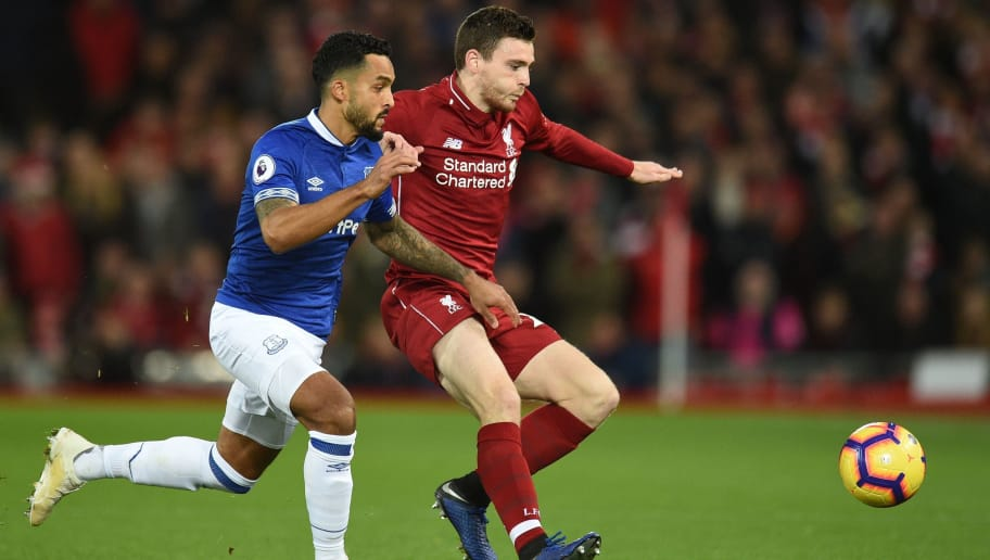Everton's English striker Theo Walcott (L) vies with Liverpool's Scottish defender Andrew Robertson (R) during the English Premier League football match between Liverpool and Everton at Anfield in Liverpool, north west England on December 2, 2018. (Photo by Oli SCARFF / AFP) / RESTRICTED TO EDITORIAL USE. No use with unauthorized audio, video, data, fixture lists, club/league logos or 'live' services. Online in-match use limited to 120 images. An additional 40 images may be used in extra time. No video emulation. Social media in-match use limited to 120 images. An additional 40 images may be used in extra time. No use in betting publications, games or single club/league/player publications. /         (Photo credit should read OLI SCARFF/AFP/Getty Images)
