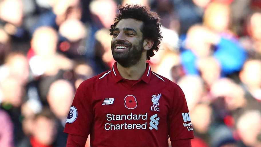 Liverpool's Egyptian midfielder Mohamed Salah smiles during the English Premier League football match between Liverpool and Fulham at Anfield in Liverpool, north west England on November 11, 2018. (Photo by Geoff CADDICK / AFP) / RESTRICTED TO EDITORIAL USE. No use with unauthorized audio, video, data, fixture lists, club/league logos or 'live' services. Online in-match use limited to 120 images. An additional 40 images may be used in extra time. No video emulation. Social media in-match use limited to 120 images. An additional 40 images may be used in extra time. No use in betting publications, games or single club/league/player publications. /         (Photo credit should read GEOFF CADDICK/AFP/Getty Images)