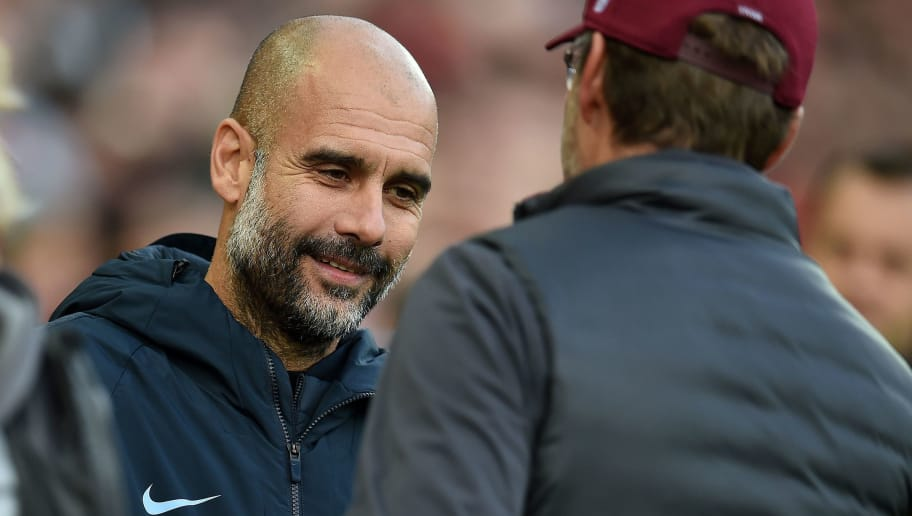 Manchester City's Spanish manager Pep Guardiola (L) greets Liverpool's German manager Jurgen Klopp before the English Premier League football match between Liverpool and Manchester City at Anfield in Liverpool, north west England on October 7, 2018. (Photo by Paul ELLIS / AFP) / RESTRICTED TO EDITORIAL USE. No use with unauthorized audio, video, data, fixture lists, club/league logos or 'live' services. Online in-match use limited to 120 images. An additional 40 images may be used in extra time. No video emulation. Social media in-match use limited to 120 images. An additional 40 images may be used in extra time. No use in betting publications, games or single club/league/player publications. /         (Photo credit should read PAUL ELLIS/AFP/Getty Images)