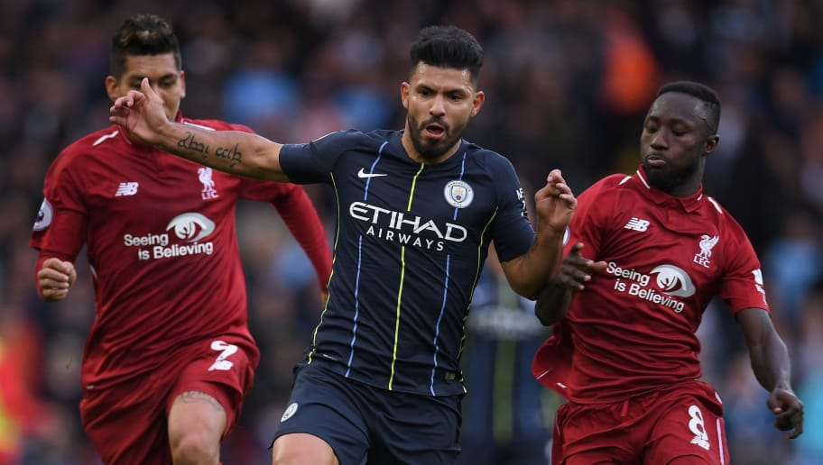 Manchester City's Argentinian striker Sergio Aguero (2R) vies with Liverpool's Scottish defender Andrew Robertson (L), Liverpool's Brazilian midfielder Roberto Firmino (2L) and Liverpool's Guinean midfielder Naby Keita during the English Premier League football match between Liverpool and Manchester City at Anfield in Liverpool, north west England on October 7, 2018. (Photo by Paul ELLIS / AFP) / RESTRICTED TO EDITORIAL USE. No use with unauthorized audio, video, data, fixture lists, club/league logos or 'live' services. Online in-match use limited to 120 images. An additional 40 images may be used in extra time. No video emulation. Social media in-match use limited to 120 images. An additional 40 images may be used in extra time. No use in betting publications, games or single club/league/player publications. /         (Photo credit should read PAUL ELLIS/AFP/Getty Images)