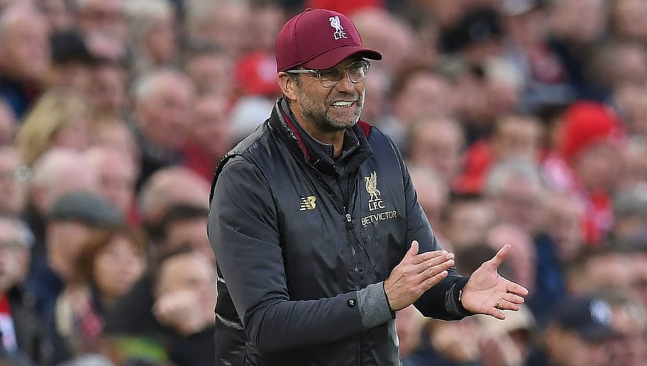 Liverpool's German manager Jurgen Klopp reacts during the English Premier League football match between Liverpool and Manchester City at Anfield in Liverpool, north west England on October 7, 2018. (Photo by Paul ELLIS / AFP) / RESTRICTED TO EDITORIAL USE. No use with unauthorized audio, video, data, fixture lists, club/league logos or 'live' services. Online in-match use limited to 120 images. An additional 40 images may be used in extra time. No video emulation. Social media in-match use limited to 120 images. An additional 40 images may be used in extra time. No use in betting publications, games or single club/league/player publications. /         (Photo credit should read PAUL ELLIS/AFP/Getty Images)