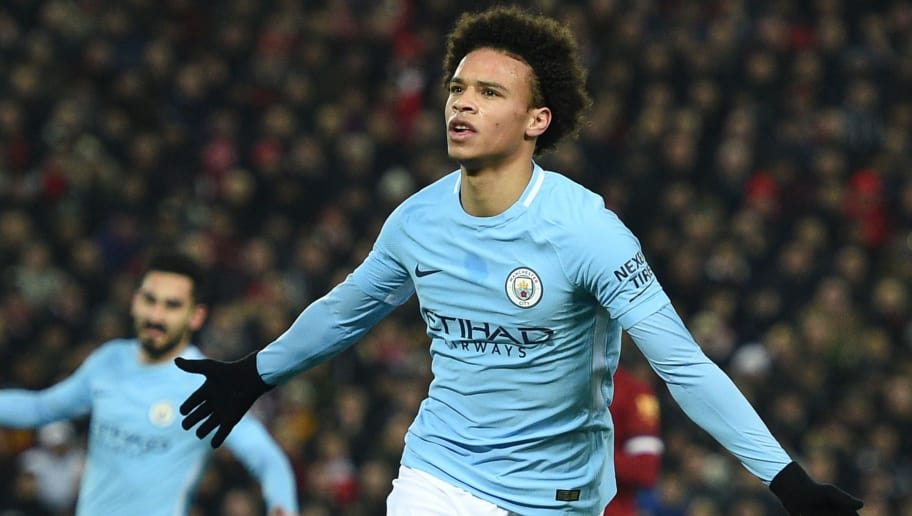 Manchester City's German midfielder Leroy Sane celebrates scoring their first goal to equalise 1-1 during the English Premier League football match between Liverpool and Manchester City at Anfield in Liverpool, north west England on January 14, 2018. / AFP PHOTO / Oli SCARFF / RESTRICTED TO EDITORIAL USE. No use with unauthorized audio, video, data, fixture lists, club/league logos or 'live' services. Online in-match use limited to 75 images, no video emulation. No use in betting, games or single club/league/player publications.  /         (Photo credit should read OLI SCARFF/AFP/Getty Images)