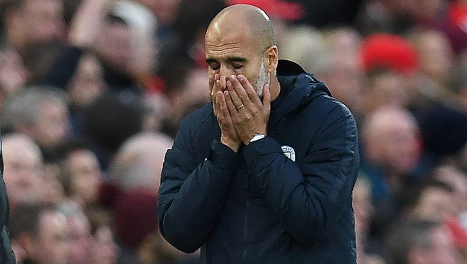 Manchester City's Spanish manager Pep Guardiola reacts after Liverpool's Dutch defender Virgil van Dijk cleared the ball with his arm, but was fouled by Manchester City's Brazilian midfielder Fernandinho in the process, during the English Premier League football match between Liverpool and Manchester City at Anfield in Liverpool, north west England on October 7, 2018. (Photo by Paul ELLIS / AFP) / RESTRICTED TO EDITORIAL USE. No use with unauthorized audio, video, data, fixture lists, club/league logos or 'live' services. Online in-match use limited to 120 images. An additional 40 images may be used in extra time. No video emulation. Social media in-match use limited to 120 images. An additional 40 images may be used in extra time. No use in betting publications, games or single club/league/player publications. /         (Photo credit should read PAUL ELLIS/AFP/Getty Images)