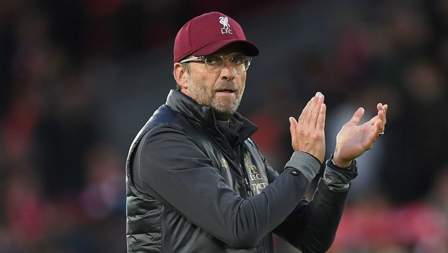 Liverpool's German manager Jurgen Klopp applauds the fans following the English Premier League football match between Liverpool and Manchester City at Anfield in Liverpool, north west England on October 7, 2018. - The match ended 0-0. (Photo by Paul ELLIS / AFP) / RESTRICTED TO EDITORIAL USE. No use with unauthorized audio, video, data, fixture lists, club/league logos or 'live' services. Online in-match use limited to 120 images. An additional 40 images may be used in extra time. No video emulation. Social media in-match use limited to 120 images. An additional 40 images may be used in extra time. No use in betting publications, games or single club/league/player publications. /         (Photo credit should read PAUL ELLIS/AFP/Getty Images)