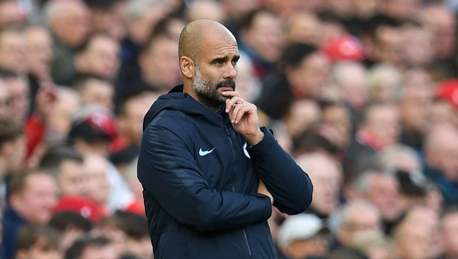 Manchester City's Spanish manager Pep Guardiola watches his players from the touchline during the English Premier League football match between Liverpool and Manchester City at Anfield in Liverpool, north west England on October 7, 2018. (Photo by Paul ELLIS / AFP) / RESTRICTED TO EDITORIAL USE. No use with unauthorized audio, video, data, fixture lists, club/league logos or 'live' services. Online in-match use limited to 120 images. An additional 40 images may be used in extra time. No video emulation. Social media in-match use limited to 120 images. An additional 40 images may be used in extra time. No use in betting publications, games or single club/league/player publications. /         (Photo credit should read PAUL ELLIS/AFP/Getty Images)