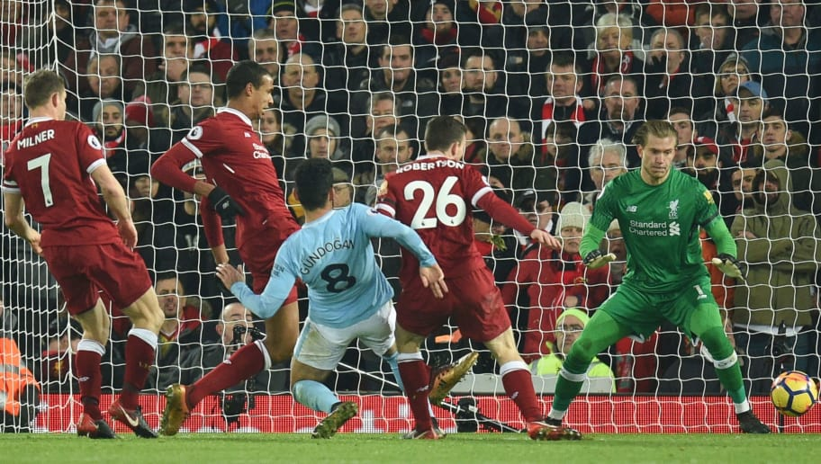 Manchester City's German midfielder Ilkay Gundogan (C) scores their third goal to make the score 4-3 during the English Premier League football match between Liverpool and Manchester City at Anfield in Liverpool, north west England on January 14, 2018. / AFP PHOTO / Oli SCARFF / RESTRICTED TO EDITORIAL USE. No use with unauthorized audio, video, data, fixture lists, club/league logos or 'live' services. Online in-match use limited to 75 images, no video emulation. No use in betting, games or single club/league/player publications.  /         (Photo credit should read OLI SCARFF/AFP/Getty Images)