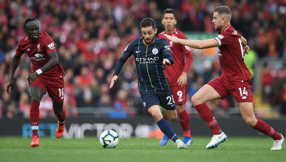 Liverpool's English midfielder Jordan Henderson (R) vies with Manchester City's Portuguese midfielder Bernardo Silva (C) during the English Premier League football match between Liverpool and Manchester City at Anfield in Liverpool, north west England on October 7, 2018. (Photo by Paul ELLIS / AFP) / RESTRICTED TO EDITORIAL USE. No use with unauthorized audio, video, data, fixture lists, club/league logos or 'live' services. Online in-match use limited to 120 images. An additional 40 images may be used in extra time. No video emulation. Social media in-match use limited to 120 images. An additional 40 images may be used in extra time. No use in betting publications, games or single club/league/player publications. /         (Photo credit should read PAUL ELLIS/AFP/Getty Images)