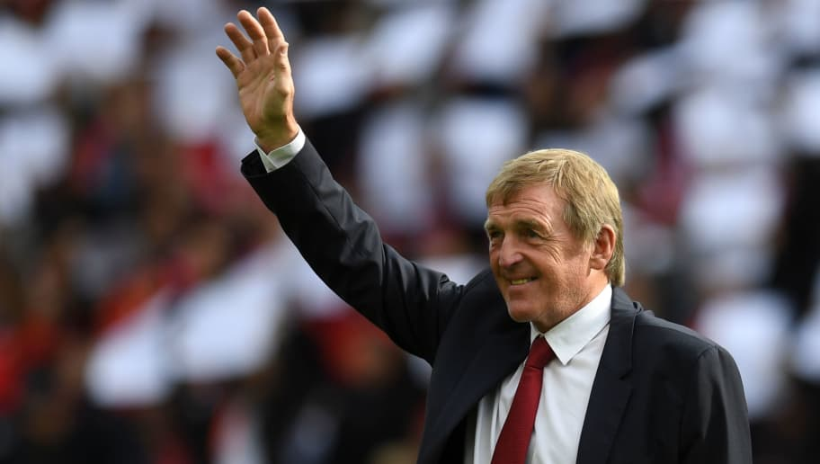 Former Liverpool player and manager Kenny Dalglish takes the applause of the supporters a day after having the new grandstand named after him, on the pitch ahead of the English Premier League football match between Liverpool and Manchester United at Anfield in Liverpool, north west England on October 14, 2017. / AFP PHOTO / Paul ELLIS / RESTRICTED TO EDITORIAL USE. No use with unauthorized audio, video, data, fixture lists, club/league logos or 'live' services. Online in-match use limited to 75 images, no video emulation. No use in betting, games or single club/league/player publications.  /         (Photo credit should read PAUL ELLIS/AFP/Getty Images)