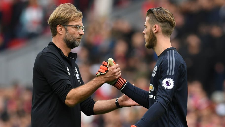 Liverpool's German manager Jurgen Klopp (L) shakes hands with Manchester United's Spanish goalkeeper David de Gea after the English Premier League football match between Liverpool and Manchester United at Anfield in Liverpool, north west England on October 14, 2017. The game ended 0-0. / AFP PHOTO / Paul ELLIS / RESTRICTED TO EDITORIAL USE. No use with unauthorized audio, video, data, fixture lists, club/league logos or 'live' services. Online in-match use limited to 75 images, no video emulation. No use in betting, games or single club/league/player publications.  /         (Photo credit should read PAUL ELLIS/AFP/Getty Images)