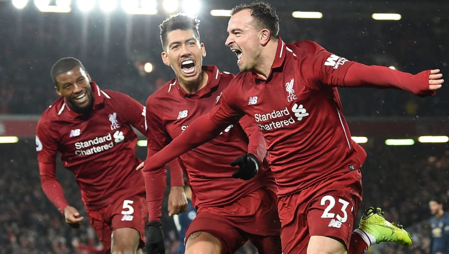 Liverpool's Swiss midfielder Xherdan Shaqiri (R) celebrates with Liverpool's Dutch midfielder Georginio Wijnaldum (L) and Liverpool's Brazilian midfielder Roberto Firmino (C) after scoring their third goal during the English Premier League football match between Liverpool and Manchester United at Anfield in Liverpool, north west England on December 16, 2018. (Photo by Paul ELLIS / AFP) / RESTRICTED TO EDITORIAL USE. No use with unauthorized audio, video, data, fixture lists, club/league logos or 'live' services. Online in-match use limited to 120 images. An additional 40 images may be used in extra time. No video emulation. Social media in-match use limited to 120 images. An additional 40 images may be used in extra time. No use in betting publications, games or single club/league/player publications. /         (Photo credit should read PAUL ELLIS/AFP/Getty Images)