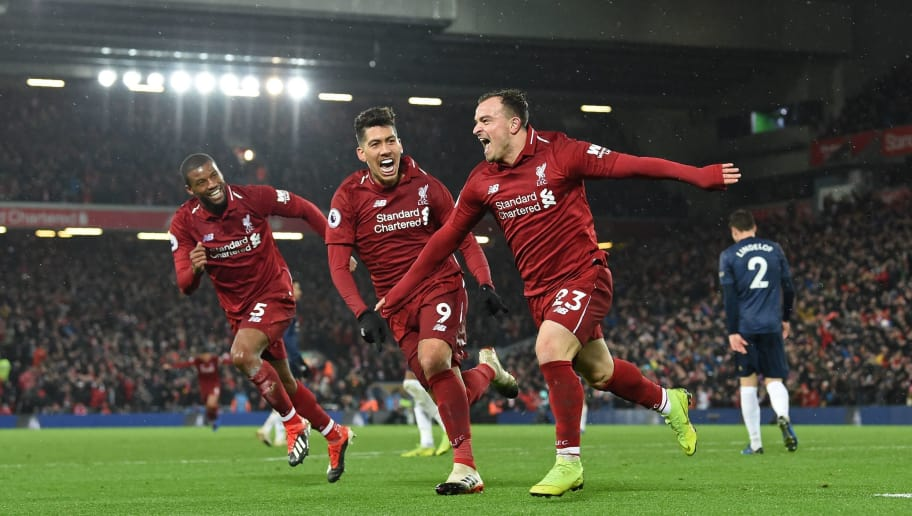 Liverpool's Swiss midfielder Xherdan Shaqiri (C) celebrates with Liverpool's Dutch midfielder Georginio Wijnaldum (L) and Liverpool's Brazilian midfielder Roberto Firmino (2nd L) after scoring their third goal during the English Premier League football match between Liverpool and Manchester United at Anfield in Liverpool, north west England on December 16, 2018. (Photo by Paul ELLIS / AFP) / RESTRICTED TO EDITORIAL USE. No use with unauthorized audio, video, data, fixture lists, club/league logos or 'live' services. Online in-match use limited to 120 images. An additional 40 images may be used in extra time. No video emulation. Social media in-match use limited to 120 images. An additional 40 images may be used in extra time. No use in betting publications, games or single club/league/player publications. /         (Photo credit should read PAUL ELLIS/AFP/Getty Images)