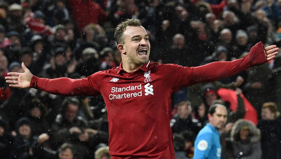 Liverpool's Swiss midfielder Xherdan Shaqiri celebrates after scoring their second goal during the English Premier League football match between Liverpool and Manchester United at Anfield in Liverpool, north west England on December 16, 2018. (Photo by Paul ELLIS / AFP) / RESTRICTED TO EDITORIAL USE. No use with unauthorized audio, video, data, fixture lists, club/league logos or 'live' services. Online in-match use limited to 120 images. An additional 40 images may be used in extra time. No video emulation. Social media in-match use limited to 120 images. An additional 40 images may be used in extra time. No use in betting publications, games or single club/league/player publications. /         (Photo credit should read PAUL ELLIS/AFP/Getty Images)