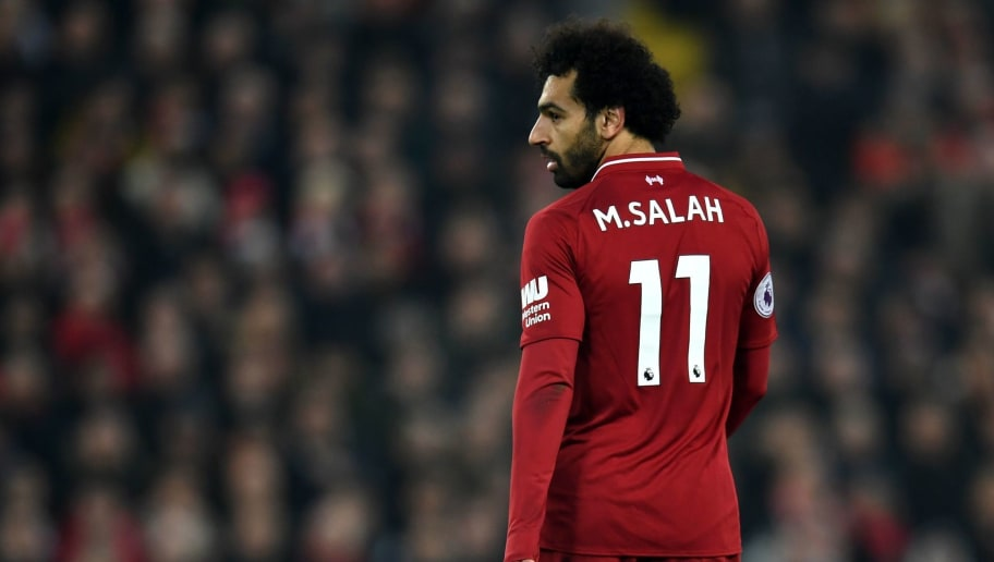 Liverpool's Egyptian midfielder Mohamed Salah looks on during the English Premier League football match between Liverpool and Newcastle United at Anfield in Liverpool, north west England on December 26, 2018. (Photo by Paul ELLIS / AFP) / RESTRICTED TO EDITORIAL USE. No use with unauthorized audio, video, data, fixture lists, club/league logos or 'live' services. Online in-match use limited to 120 images. An additional 40 images may be used in extra time. No video emulation. Social media in-match use limited to 120 images. An additional 40 images may be used in extra time. No use in betting publications, games or single club/league/player publications. /         (Photo credit should read PAUL ELLIS/AFP/Getty Images)