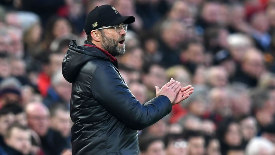 Liverpool's German manager Jurgen Klopp gestures on the touchline during the English Premier League football match between Liverpool and Newcastle United at Anfield in Liverpool, north west England on December 26, 2018. (Photo by Paul ELLIS / AFP) / RESTRICTED TO EDITORIAL USE. No use with unauthorized audio, video, data, fixture lists, club/league logos or 'live' services. Online in-match use limited to 120 images. An additional 40 images may be used in extra time. No video emulation. Social media in-match use limited to 120 images. An additional 40 images may be used in extra time. No use in betting publications, games or single club/league/player publications. /         (Photo credit should read PAUL ELLIS/AFP/Getty Images)