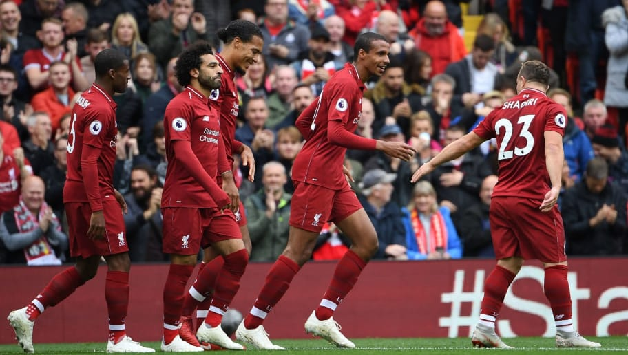 Liverpool's German-born Cameroonian defender Joel Matip (2R) celebrates with Liverpool's Swiss midfielder Xherdan Shaqiri (R) after scoring the team's second goal during the English Premier League football match between Liverpool and Southampton at Anfield in Liverpool, north west England on September 22, 2018. (Photo by Paul ELLIS / AFP) / RESTRICTED TO EDITORIAL USE. No use with unauthorized audio, video, data, fixture lists, club/league logos or 'live' services. Online in-match use limited to 120 images. An additional 40 images may be used in extra time. No video emulation. Social media in-match use limited to 120 images. An additional 40 images may be used in extra time. No use in betting publications, games or single club/league/player publications. /         (Photo credit should read PAUL ELLIS/AFP/Getty Images)