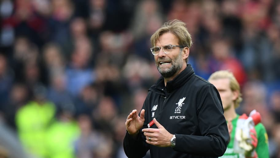 Liverpool's German manager Jurgen Klopp gestures at the final whistle during the English Premier League football match between Liverpool and Stoke City at Anfield in Liverpool, north west England on April 28, 2018. (Photo by Paul ELLIS / AFP) / RESTRICTED TO EDITORIAL USE. No use with unauthorized audio, video, data, fixture lists, club/league logos or 'live' services. Online in-match use limited to 75 images, no video emulation. No use in betting, games or single club/league/player publications. /         (Photo credit should read PAUL ELLIS/AFP/Getty Images)