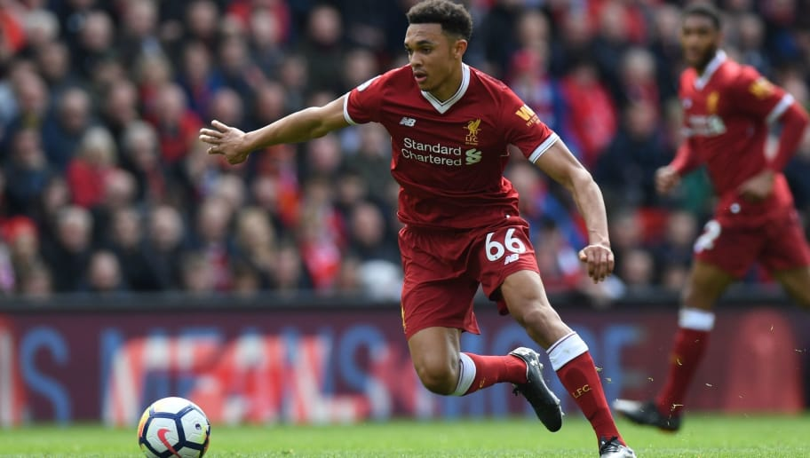 Liverpool's English midfielder Trent Alexander-Arnold controls the ball during the English Premier League football match between Liverpool and Stoke City at Anfield in Liverpool, north west England on April 28, 2018. (Photo by Paul ELLIS / AFP) / RESTRICTED TO EDITORIAL USE. No use with unauthorized audio, video, data, fixture lists, club/league logos or 'live' services. Online in-match use limited to 75 images, no video emulation. No use in betting, games or single club/league/player publications. /         (Photo credit should read PAUL ELLIS/AFP/Getty Images)