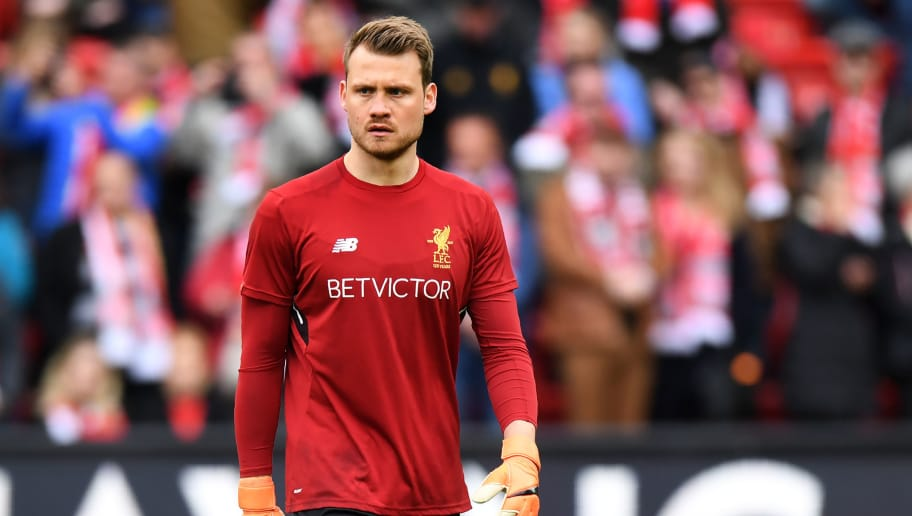 c6ac1e1f2 Liverpool s Belgian goalkeeper Simon Mignolet warms up before the English  Premier League football match between Liverpool