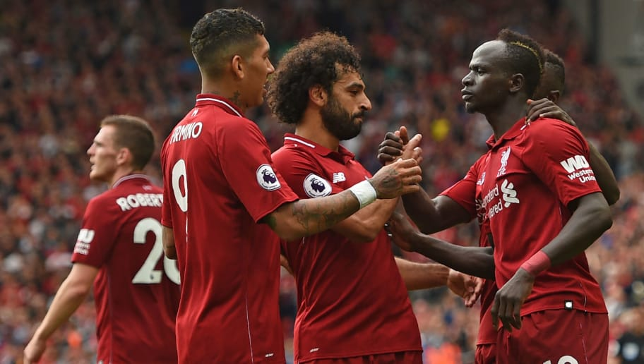 Liverpool's Senegalese striker Sadio Mané (R) celebrates with teammates after scoring their third goal during the English Premier League football match between Liverpool and West Ham United at Anfield in Liverpool, north west England on August 12, 2018. (Photo by Oli SCARFF / AFP) / RESTRICTED TO EDITORIAL USE. No use with unauthorized audio, video, data, fixture lists, club/league logos or 'live' services. Online in-match use limited to 120 images. An additional 40 images may be used in extra time. No video emulation. Social media in-match use limited to 120 images. An additional 40 images may be used in extra time. No use in betting publications, games or single club/league/player publications. /         (Photo credit should read OLI SCARFF/AFP/Getty Images)