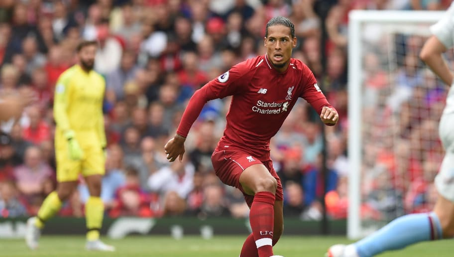 Liverpool's Dutch defender Virgil van Dijk controls the ball during the English Premier League football match between Liverpool and West Ham United at Anfield in Liverpool, north west England on August 12, 2018. (Photo by Oli SCARFF / AFP) / RESTRICTED TO EDITORIAL USE. No use with unauthorized audio, video, data, fixture lists, club/league logos or 'live' services. Online in-match use limited to 120 images. An additional 40 images may be used in extra time. No video emulation. Social media in-match use limited to 120 images. An additional 40 images may be used in extra time. No use in betting publications, games or single club/league/player publications. /         (Photo credit should read OLI SCARFF/AFP/Getty Images)