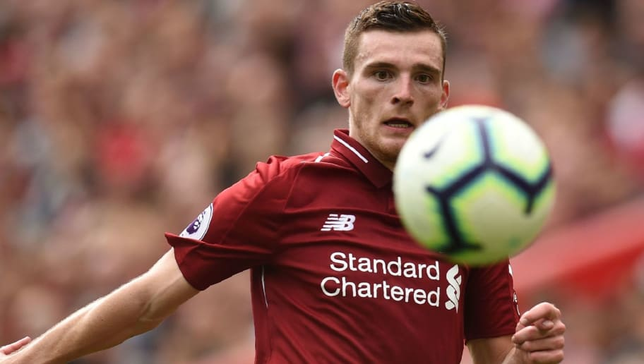 Liverpool's Scottish defender Andrew Robertson chases the ball during the English Premier League football match between Liverpool and West Ham United at Anfield in Liverpool, north west England on August 12, 2018. - Liverpool won the game 4-0. (Photo by Oli SCARFF / AFP) / RESTRICTED TO EDITORIAL USE. No use with unauthorized audio, video, data, fixture lists, club/league logos or 'live' services. Online in-match use limited to 120 images. An additional 40 images may be used in extra time. No video emulation. Social media in-match use limited to 120 images. An additional 40 images may be used in extra time. No use in betting publications, games or single club/league/player publications. /         (Photo credit should read OLI SCARFF/AFP/Getty Images)