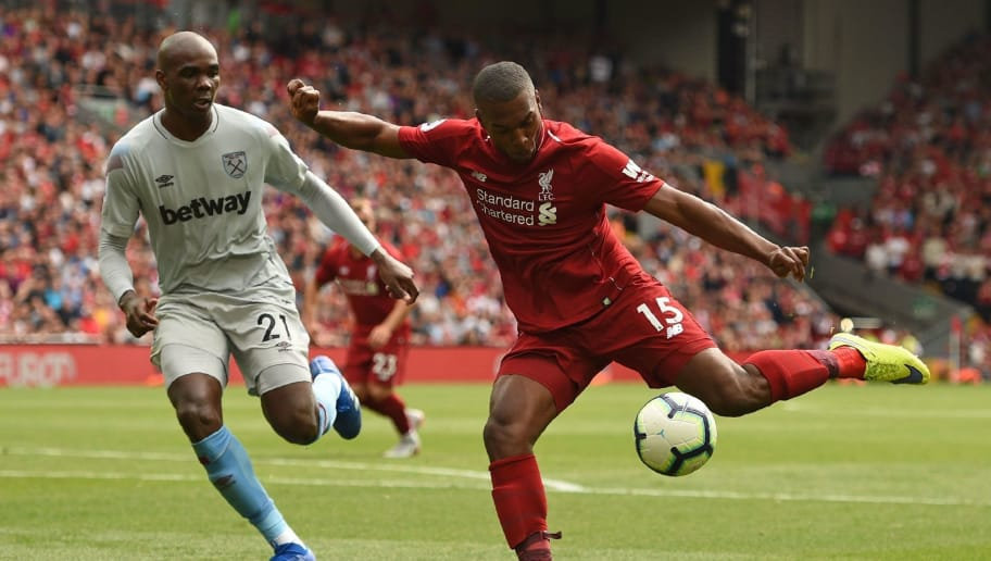 Liverpool's English striker Daniel Sturridge (R) prepares to shoot during the English Premier League football match between Liverpool and West Ham United at Anfield in Liverpool, north west England on August 12, 2018. (Photo by Oli SCARFF / AFP) / RESTRICTED TO EDITORIAL USE. No use with unauthorized audio, video, data, fixture lists, club/league logos or 'live' services. Online in-match use limited to 120 images. An additional 40 images may be used in extra time. No video emulation. Social media in-match use limited to 120 images. An additional 40 images may be used in extra time. No use in betting publications, games or single club/league/player publications. /         (Photo credit should read OLI SCARFF/AFP/Getty Images)