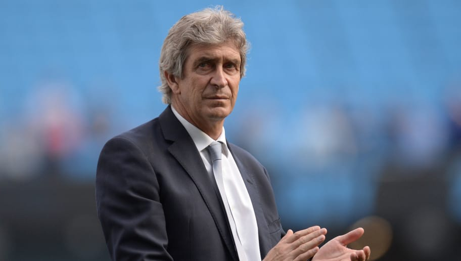Manchester City's Chilean manager Manuel Pellegrini applauds the fans after the English Premier League football match between Manchester City and Arsenal at the Etihad Stadium in Manchester, north west England, on May 8, 2016. / AFP / OLI SCARFF / RESTRICTED TO EDITORIAL USE. No use with unauthorized audio, video, data, fixture lists, club/league logos or 'live' services. Online in-match use limited to 75 images, no video emulation. No use in betting, games or single club/league/player publications.  /         (Photo credit should read OLI SCARFF/AFP/Getty Images)