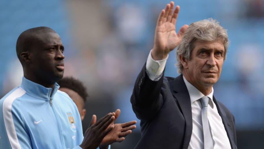 Manchester City's Ivorian midfielder and captain Yaya Toure (L) and Manchester City's Chilean manager Manuel Pellegrini applaud the fans after the English Premier League football match between Manchester City and Arsenal at the Etihad Stadium in Manchester, north west England, on May 8, 2016. / AFP / OLI SCARFF / RESTRICTED TO EDITORIAL USE. No use with unauthorized audio, video, data, fixture lists, club/league logos or 'live' services. Online in-match use limited to 75 images, no video emulation. No use in betting, games or single club/league/player publications.  /         (Photo credit should read OLI SCARFF/AFP/Getty Images)