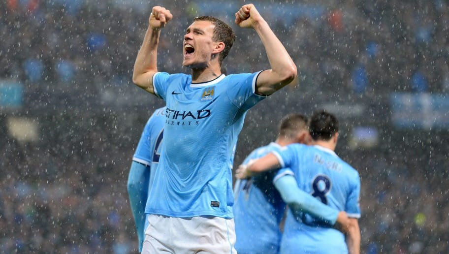 Manchester City's Bosnian striker Edin Dzeko celebrates scoring his first goal during the English Premier League football match between Manchester City and Aston Villa at the Etihad Stadium in Manchester, Northwest England, on May 7, 2014. AFP PHOTO/ANDREW YATES RESTRICTED TO EDITORIAL USE. NO USE WITH UNAUTHORIZED AUDIO, VIDEO, DATA, FIXTURE LISTS, CLUB/LEAGUE LOGOS OR LIVE SERVICES. ONLINE IN-MATCH USE LIMITED TO 45 IMAGES, NO VIDEO EMULATION. NO USE IN BETTING, GAMES OR SINGLE CLUB/LEAGUE/PLAYER PUBLICATIONS        (Photo credit should read ANDREW YATES/AFP/Getty Images)