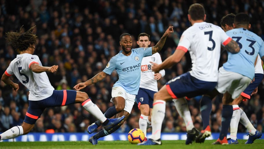 Manchester City's English midfielder Raheem Sterling (C) takes on Bournemouth's Dutch defender Nathan Ake (L) during the English Premier League football match between Manchester City and Bournemouth at the Etihad Stadium in Manchester, north west England, on December 1, 2018. (Photo by Paul ELLIS / AFP) / RESTRICTED TO EDITORIAL USE. No use with unauthorized audio, video, data, fixture lists, club/league logos or 'live' services. Online in-match use limited to 120 images. An additional 40 images may be used in extra time. No video emulation. Social media in-match use limited to 120 images. An additional 40 images may be used in extra time. No use in betting publications, games or single club/league/player publications. /         (Photo credit should read PAUL ELLIS/AFP/Getty Images)
