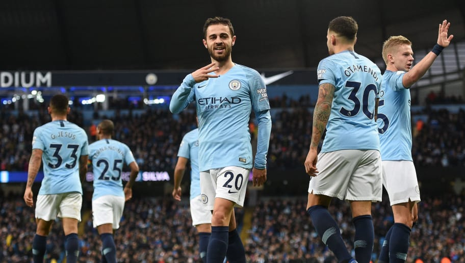Manchester City's Portuguese midfielder Bernardo Silva (C) celebrates scoring the opening goal during the English Premier League football match between Manchester City and Bournemouth at the Etihad Stadium in Manchester, north west England, on December 1, 2018. (Photo by Oli SCARFF / AFP) / RESTRICTED TO EDITORIAL USE. No use with unauthorized audio, video, data, fixture lists, club/league logos or 'live' services. Online in-match use limited to 120 images. An additional 40 images may be used in extra time. No video emulation. Social media in-match use limited to 120 images. An additional 40 images may be used in extra time. No use in betting publications, games or single club/league/player publications. /         (Photo credit should read OLI SCARFF/AFP/Getty Images)