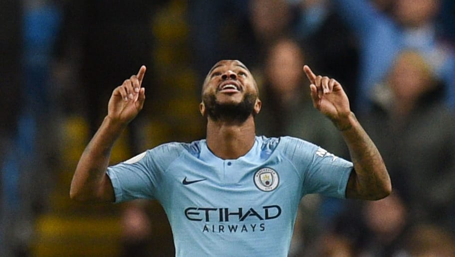 Manchester City's English midfielder Raheem Sterling celebrates scoring their second goal for 2-1 during the English Premier League football match between Manchester City and Bournemouth at the Etihad Stadium in Manchester, north west England, on December 1, 2018. (Photo by Oli SCARFF / AFP) / RESTRICTED TO EDITORIAL USE. No use with unauthorized audio, video, data, fixture lists, club/league logos or 'live' services. Online in-match use limited to 120 images. An additional 40 images may be used in extra time. No video emulation. Social media in-match use limited to 120 images. An additional 40 images may be used in extra time. No use in betting publications, games or single club/league/player publications. /         (Photo credit should read OLI SCARFF/AFP/Getty Images)