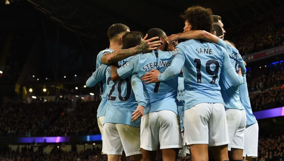 Manchester City's German midfielder Ilkay Gundogan (R) celebrates scoring their third goal for 3-1 with team-mates during the English Premier League football match between Manchester City and Bournemouth at the Etihad Stadium in Manchester, north west England, on December 1, 2018. (Photo by Paul ELLIS / AFP) / RESTRICTED TO EDITORIAL USE. No use with unauthorized audio, video, data, fixture lists, club/league logos or 'live' services. Online in-match use limited to 120 images. An additional 40 images may be used in extra time. No video emulation. Social media in-match use limited to 120 images. An additional 40 images may be used in extra time. No use in betting publications, games or single club/league/player publications. /         (Photo credit should read PAUL ELLIS/AFP/Getty Images)