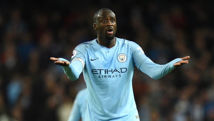Manchester City's Ivorian midfielder Yaya Toure reacts to a decision by the referee during the English Premier League football match between Manchester City and Brighton and Hove Albion at the Etihad Stadium in Manchester, north west England, on May 9, 2018. (Photo by Oli SCARFF / AFP) / RESTRICTED TO EDITORIAL USE. No use with unauthorized audio, video, data, fixture lists, club/league logos or 'live' services. Online in-match use limited to 75 images, no video emulation. No use in betting, games or single club/league/player publications. /         (Photo credit should read OLI SCARFF/AFP/Getty Images)