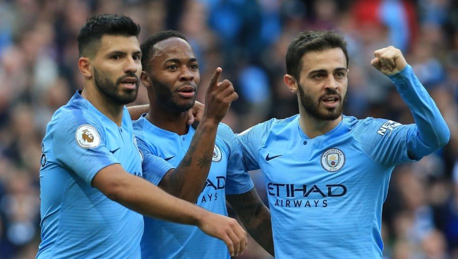 Manchester City's English midfielder Raheem Sterling (C) celebrates with Manchester City's Argentinian striker Sergio Aguero (L) and Manchester City's Portuguese midfielder Bernardo Silva after scoring the team's first goal during the English Premier League football match between Manchester City and Brighton and Hove Albion at the Etihad Stadium in Manchester, north west England, on September 29, 2018. (Photo by Lindsey PARNABY / AFP) / RESTRICTED TO EDITORIAL USE. No use with unauthorized audio, video, data, fixture lists, club/league logos or 'live' services. Online in-match use limited to 120 images. An additional 40 images may be used in extra time. No video emulation. Social media in-match use limited to 120 images. An additional 40 images may be used in extra time. No use in betting publications, games or single club/league/player publications. /         (Photo credit should read LINDSEY PARNABY/AFP/Getty Images)