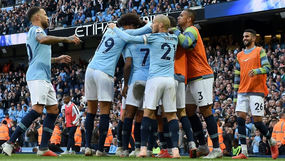 Manchester City's Argentinian striker Sergio Aguero celebrates with teammates after scoring the team's second goal during the English Premier League football match between Manchester City and Brighton and Hove Albion at the Etihad Stadium in Manchester, north west England, on September 29, 2018. (Photo by Paul ELLIS / AFP) / RESTRICTED TO EDITORIAL USE. No use with unauthorized audio, video, data, fixture lists, club/league logos or 'live' services. Online in-match use limited to 120 images. An additional 40 images may be used in extra time. No video emulation. Social media in-match use limited to 120 images. An additional 40 images may be used in extra time. No use in betting publications, games or single club/league/player publications. /         (Photo credit should read PAUL ELLIS/AFP/Getty Images)