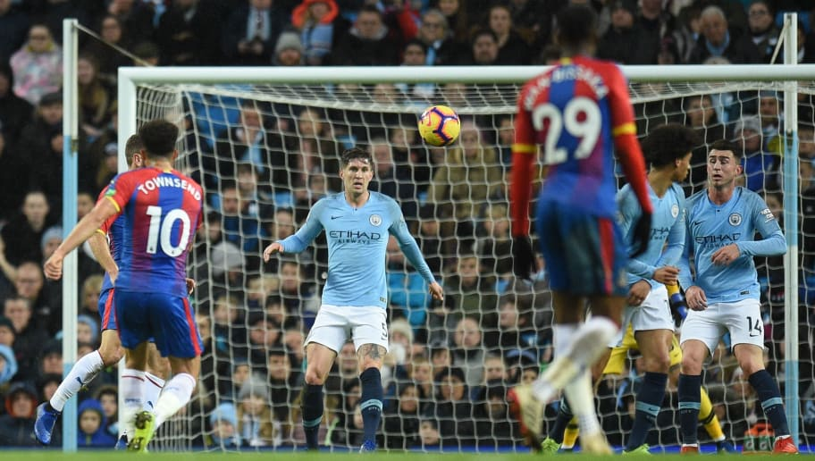Crystal Palace's English midfielder Andros Townsend (L) strikes the ball to score their second goal to take the lead 1-2 during the English Premier League football match between Manchester City and Crystal Palace at the Etihad Stadium in Manchester, north west England, on December 22, 2018. (Photo by Oli SCARFF / AFP) / RESTRICTED TO EDITORIAL USE. No use with unauthorized audio, video, data, fixture lists, club/league logos or 'live' services. Online in-match use limited to 120 images. An additional 40 images may be used in extra time. No video emulation. Social media in-match use limited to 120 images. An additional 40 images may be used in extra time. No use in betting publications, games or single club/league/player publications. /         (Photo credit should read OLI SCARFF/AFP/Getty Images)