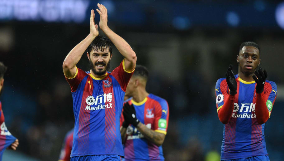 Crystal Palace's English defender James Tomkins (2L) celebrates after the final whistle during the English Premier League football match between Manchester City and Crystal Palace at the Etihad Stadium in Manchester, north west England, on December 22, 2018. (Photo by Oli SCARFF / AFP) / RESTRICTED TO EDITORIAL USE. No use with unauthorized audio, video, data, fixture lists, club/league logos or 'live' services. Online in-match use limited to 120 images. An additional 40 images may be used in extra time. No video emulation. Social media in-match use limited to 120 images. An additional 40 images may be used in extra time. No use in betting publications, games or single club/league/player publications. /         (Photo credit should read OLI SCARFF/AFP/Getty Images)