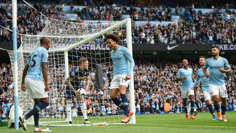 Manchester City's German midfielder Leroy Sane (C) celebrates with Manchester City's Brazilian midfielder Fernandinho after scoring during the English Premier League football match between Manchester City and Fulham at the Etihad Stadium in Manchester, north west England, on September 15, 2018. (Photo by Oli SCARFF / AFP) / RESTRICTED TO EDITORIAL USE. No use with unauthorized audio, video, data, fixture lists, club/league logos or 'live' services. Online in-match use limited to 120 images. An additional 40 images may be used in extra time. No video emulation. Social media in-match use limited to 120 images. An additional 40 images may be used in extra time. No use in betting publications, games or single club/league/player publications. /         (Photo credit should read OLI SCARFF/AFP/Getty Images)