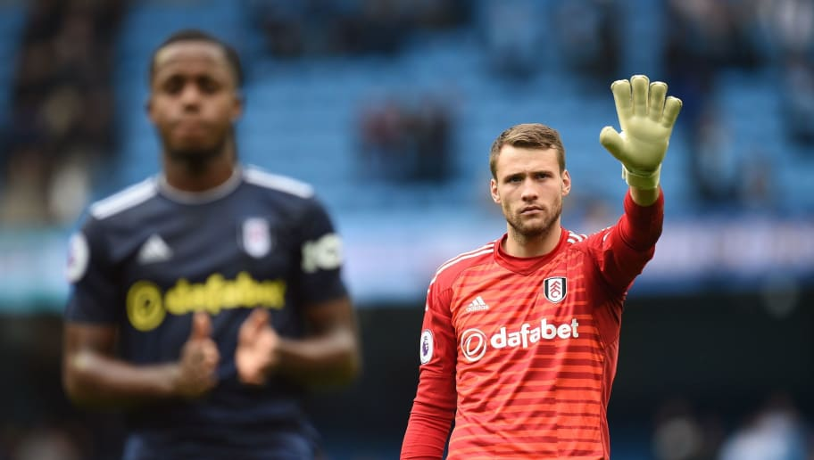 Fulham's English goalkeeper Marcus Bettinelli waves to fans after losing the English Premier League football match between Manchester City and Fulham at the Etihad Stadium in Manchester, north west England, on September 15, 2018. (Photo by Oli SCARFF / AFP) / RESTRICTED TO EDITORIAL USE. No use with unauthorized audio, video, data, fixture lists, club/league logos or 'live' services. Online in-match use limited to 120 images. An additional 40 images may be used in extra time. No video emulation. Social media in-match use limited to 120 images. An additional 40 images may be used in extra time. No use in betting publications, games or single club/league/player publications. /         (Photo credit should read OLI SCARFF/AFP/Getty Images)