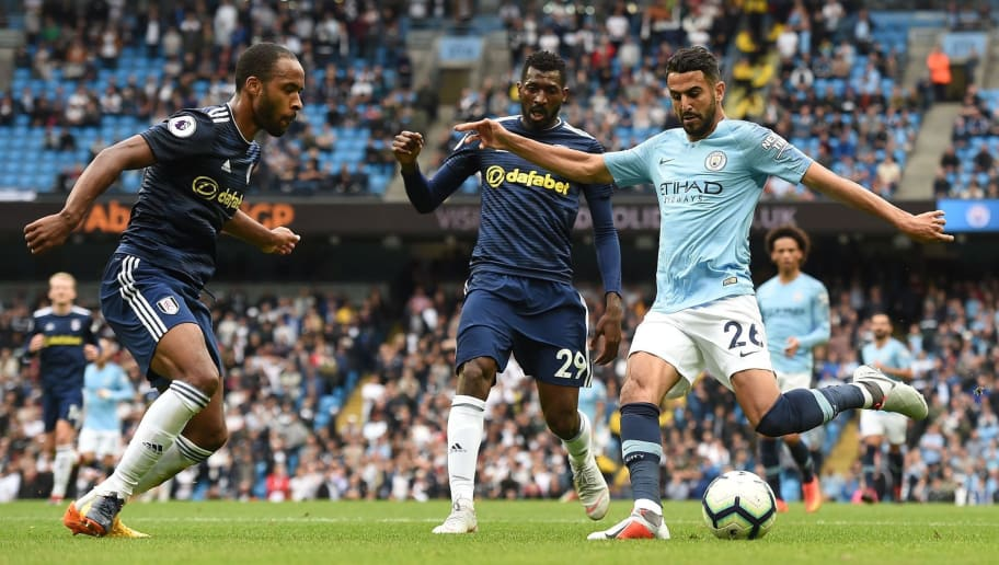 Fulham's Belgian defender Denis Odoi vies with Manchester City's Algerian midfielder Riyad Mahrez during the English Premier League football match between Manchester City and Fulham at the Etihad Stadium in Manchester, north west England, on September 15, 2018. (Photo by Paul ELLIS / AFP) / RESTRICTED TO EDITORIAL USE. No use with unauthorized audio, video, data, fixture lists, club/league logos or 'live' services. Online in-match use limited to 120 images. An additional 40 images may be used in extra time. No video emulation. Social media in-match use limited to 120 images. An additional 40 images may be used in extra time. No use in betting publications, games or single club/league/player publications. /         (Photo credit should read PAUL ELLIS/AFP/Getty Images)