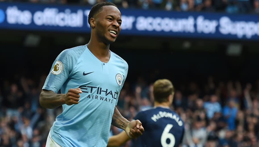 Manchester City's English midfielder Raheem Sterling celebrates after scoring their third goal during the English Premier League football match between Manchester City and Fulham at the Etihad Stadium in Manchester, north west England, on September 15, 2018. (Photo by Paul ELLIS / AFP) / RESTRICTED TO EDITORIAL USE. No use with unauthorized audio, video, data, fixture lists, club/league logos or 'live' services. Online in-match use limited to 120 images. An additional 40 images may be used in extra time. No video emulation. Social media in-match use limited to 120 images. An additional 40 images may be used in extra time. No use in betting publications, games or single club/league/player publications. /         (Photo credit should read PAUL ELLIS/AFP/Getty Images)
