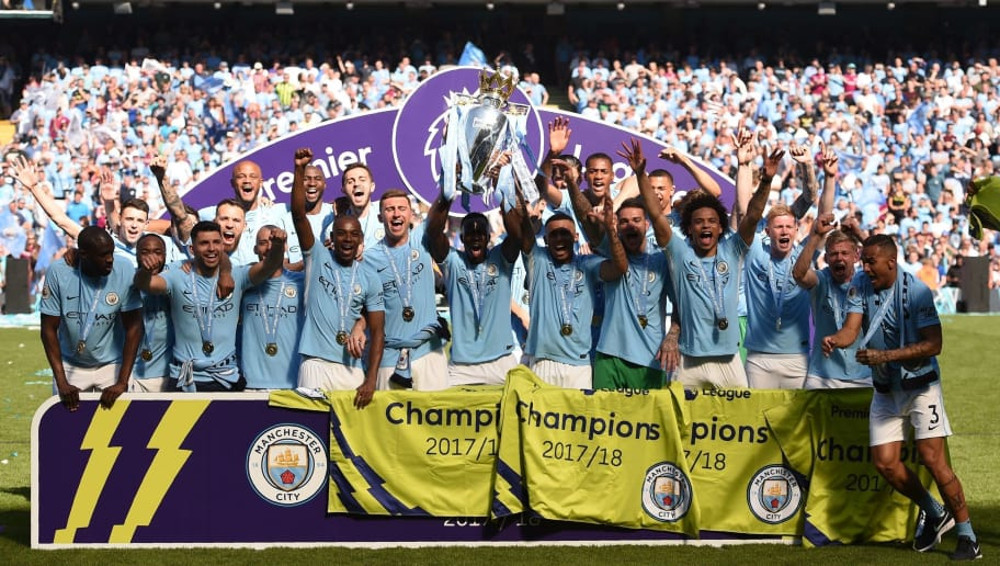 Manchester City players celebrate with the Premier League trophy on the pitch after the English Premier League football match between Manchester City and Huddersfield Town at the Etihad Stadium in Manchester, north west England, on May 6, 2018. (Photo by Oli SCARFF / AFP) / RESTRICTED TO EDITORIAL USE. No use with unauthorized audio, video, data, fixture lists, club/league logos or 'live' services. Online in-match use limited to 75 images, no video emulation. No use in betting, games or single club/league/player publications. /         (Photo credit should read OLI SCARFF/AFP/Getty Images)