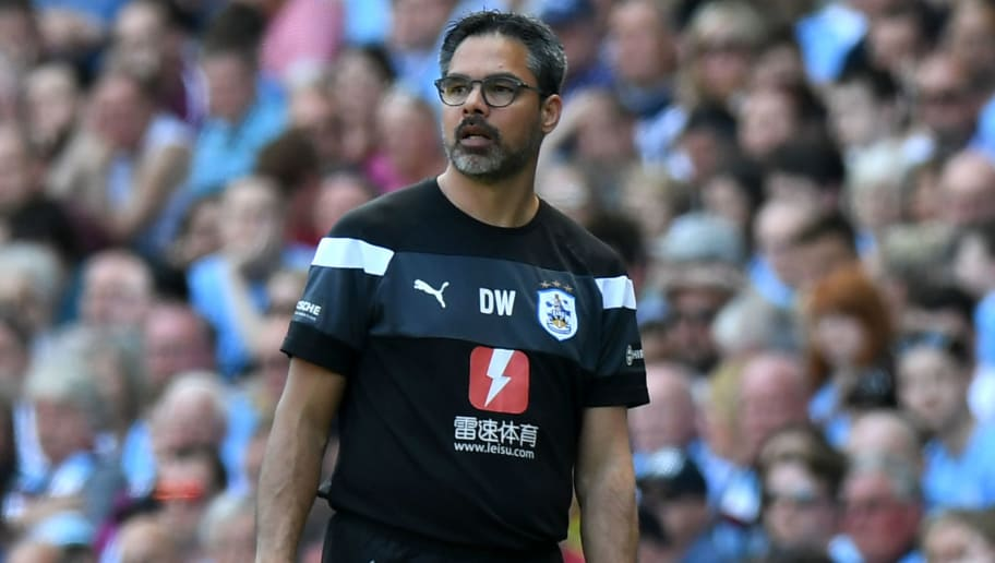 Huddersfield Town's German head coach David Wagner looks on during the English Premier League football match between Manchester City and Huddersfield Town at the Etihad Stadium in Manchester, north west England, on May 6, 2018. (Photo by Paul ELLIS / AFP) / RESTRICTED TO EDITORIAL USE. No use with unauthorized audio, video, data, fixture lists, club/league logos or 'live' services. Online in-match use limited to 75 images, no video emulation. No use in betting, games or single club/league/player publications. /         (Photo credit should read PAUL ELLIS/AFP/Getty Images)