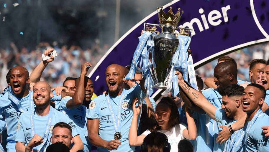 Manchester City's captian, Belgian defender Vincent Kompany lifts the Premier League trophy on the pitch after the English Premier League football match between Manchester City and Huddersfield Town at the Etihad Stadium in Manchester, north west England, on May 6, 2018. (Photo by Oli SCARFF / AFP) / RESTRICTED TO EDITORIAL USE. No use with unauthorized audio, video, data, fixture lists, club/league logos or 'live' services. Online in-match use limited to 75 images, no video emulation. No use in betting, games or single club/league/player publications. /         (Photo credit should read OLI SCARFF/AFP/Getty Images)