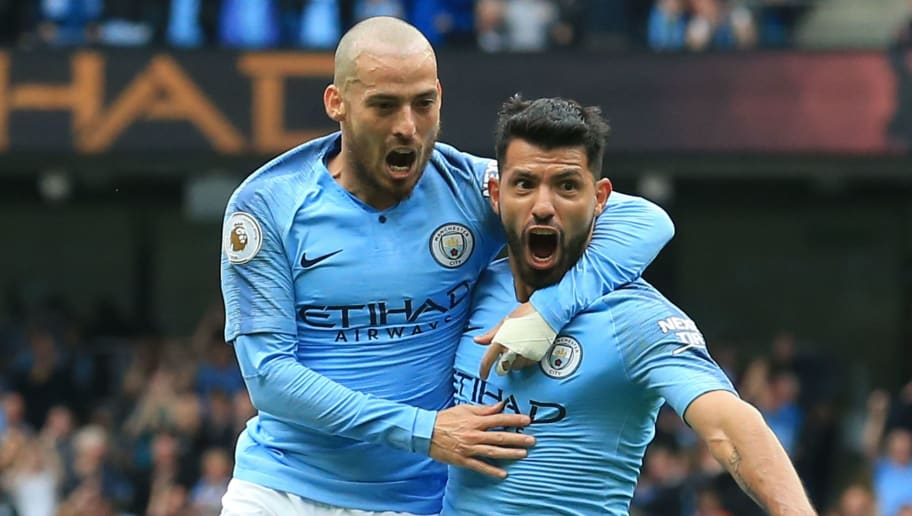 Manchester City's Argentinian striker Sergio Aguero (R) celebrates scoring the opening goal with Manchester City's Spanish midfielder David Silva (L) during the English Premier League football match between Manchester City and Huddersfield Town at the Etihad Stadium in Manchester, north west England, on August 19, 2018. (Photo by Lindsey PARNABY / AFP) / RESTRICTED TO EDITORIAL USE. No use with unauthorized audio, video, data, fixture lists, club/league logos or 'live' services. Online in-match use limited to 120 images. An additional 40 images may be used in extra time. No video emulation. Social media in-match use limited to 120 images. An additional 40 images may be used in extra time. No use in betting publications, games or single club/league/player publications. /         (Photo credit should read LINDSEY PARNABY/AFP/Getty Images)
