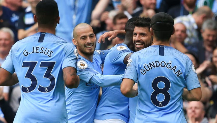 Manchester City's Argentinian striker Sergio Aguero (2R) celebrates scoring their third goal with team-mates (L-R) Manchester City's Brazilian striker Gabriel Jesus, Manchester City's Spanish midfielder David Silva, Manchester City's French defender Benjamin Mendy and Manchester City's German midfielder Ilkay Gundogan during the English Premier League football match between Manchester City and Huddersfield Town at the Etihad Stadium in Manchester, north west England, on August 19, 2018. (Photo by Lindsey PARNABY / AFP) / RESTRICTED TO EDITORIAL USE. No use with unauthorized audio, video, data, fixture lists, club/league logos or 'live' services. Online in-match use limited to 120 images. An additional 40 images may be used in extra time. No video emulation. Social media in-match use limited to 120 images. An additional 40 images may be used in extra time. No use in betting publications, games or single club/league/player publications. /         (Photo credit should read LINDSEY PARNABY/AFP/Getty Images)