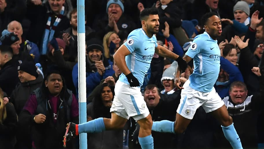 Manchester City's English midfielder Raheem Sterling (R) celebrates with Manchester City's Argentinian striker Sergio Aguero after scoring the opening goal of the English Premier League football match between Manchester City and Leicester City at the Etihad Stadium in Manchester, north west England, on February 10, 2018. / AFP PHOTO / Paul ELLIS / RESTRICTED TO EDITORIAL USE. No use with unauthorized audio, video, data, fixture lists, club/league logos or 'live' services. Online in-match use limited to 75 images, no video emulation. No use in betting, games or single club/league/player publications.  /         (Photo credit should read PAUL ELLIS/AFP/Getty Images)