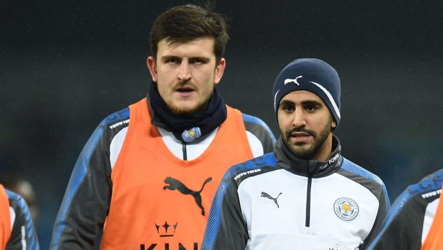 Leicester City's English defender Harry Maguire (L) and Leicester City's Algerian midfielder Riyad Mahrez (C) warm up ahead of the English Premier League football match between Manchester City and Leicester City at the Etihad Stadium in Manchester, north west England, on February 10, 2018. / AFP PHOTO / Oli SCARFF / RESTRICTED TO EDITORIAL USE. No use with unauthorized audio, video, data, fixture lists, club/league logos or 'live' services. Online in-match use limited to 75 images, no video emulation. No use in betting, games or single club/league/player publications.  /         (Photo credit should read OLI SCARFF/AFP/Getty Images)