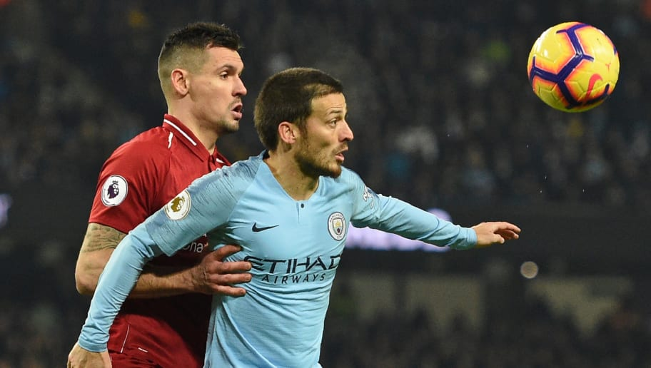 Liverpool's Croatian defender Dejan Lovren (L) vies with Manchester City's Spanish midfielder David Silva (R) during the English Premier League football match between Manchester City and Liverpool at the Etihad Stadium in Manchester, north west England, on January 3, 2019. (Photo by Oli SCARFF / AFP) / RESTRICTED TO EDITORIAL USE. No use with unauthorized audio, video, data, fixture lists, club/league logos or 'live' services. Online in-match use limited to 120 images. An additional 40 images may be used in extra time. No video emulation. Social media in-match use limited to 120 images. An additional 40 images may be used in extra time. No use in betting publications, games or single club/league/player publications. /         (Photo credit should read OLI SCARFF/AFP/Getty Images)
